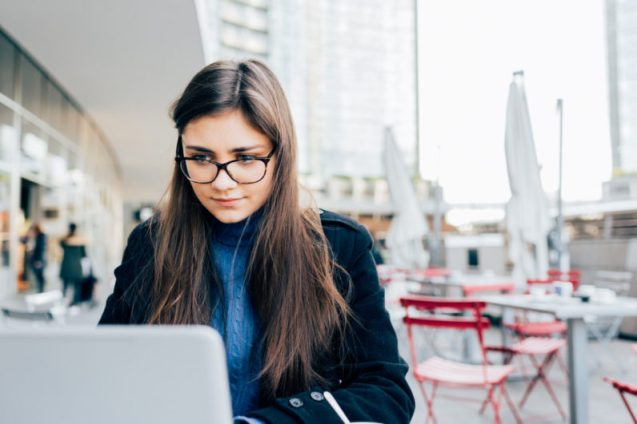 graphicstock-young-beautiful-eastern-business-woman-outdoor-in-the-city-sitting-bar-using-computer-business-work-technology-concept_rTxo2IVqyb-796x531